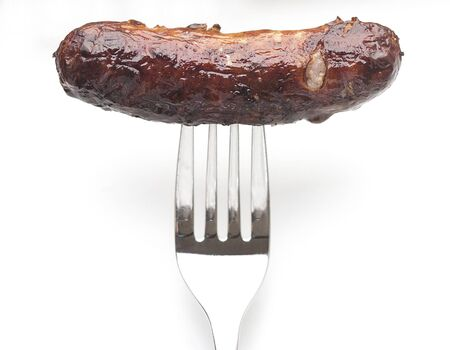 sausage on fork on white background 스톡 콘텐츠