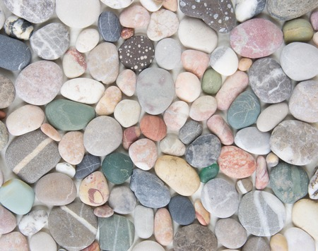 Sea pebble background. Sea stones colorful background 写真素材