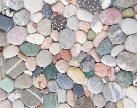 Tło kamyk morza. Kamienie morskie kolorowe tło