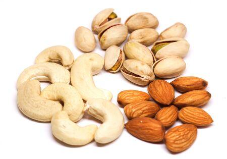 Close up shot of Cashews, Badam and Pistachios