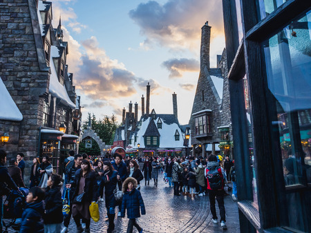 Osaka, Japan - November 19, 2017: The Wizarding World of Harry Potter in Universal Studios Japan. hogsmeade at sunset