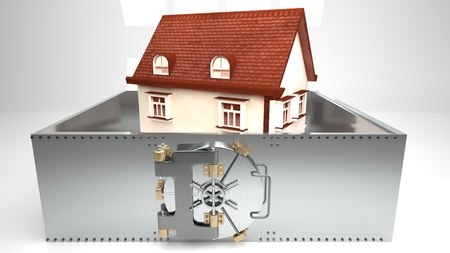 Small white house with a roof made of red shingles surrounded by a metal wall secured by a round metal bank vault doors, white background, isolated, symbolizes high house prices and mortgages Stock Photo