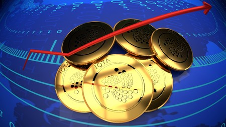 Iota value graph, rising digital currency symbolized by gold iota coins and blue digital background.