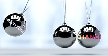 Gratitude and New Year's change - pictured as word Gratitude and a Newton cradle, to symbolize that Gratitude can change life for better, 3d illustration