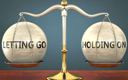 letting go and holding on staying in balance - pictured as a metal scale with weights and labels letting go and holding on to symbolize balance and symmetry of those concepts, 3d illustration