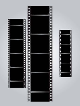 stood: a set of three black films stood in a vertical position Stock Photo