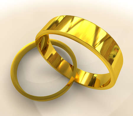 entwined: Pair of classical golden wedding rigs entwined together with shadow