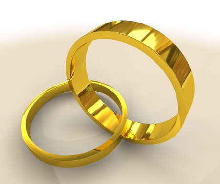 two golden wedding bands linked together as in marriage photo