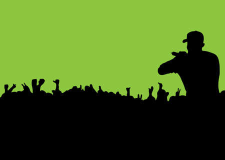 rock or rap concert with people in silhouette waving hands and fists photo