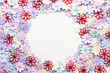 Embroidery colorful flowers pattern texture and background on a white background for Wedding invitation or greeting card. Stock Photo