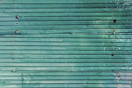 Corrugated Galvanized steel green color iron metal sheet with rusty surface for texture and background. Imagens