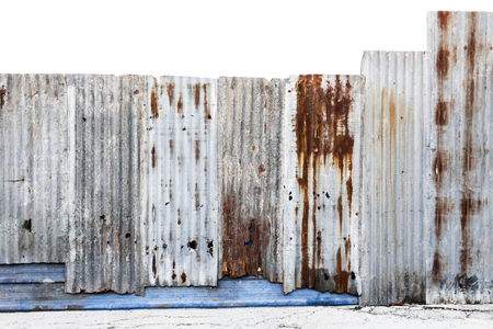 Rusty corrugated galvanized steel wall or iron metal sheet surface for texture and background. With clipping path.