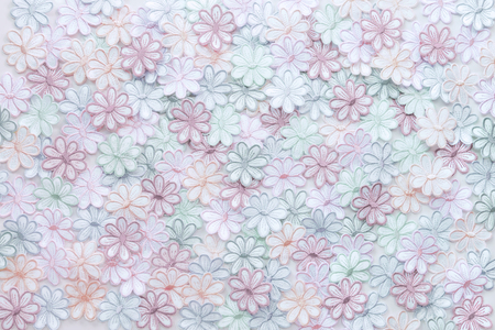 Embroidery colorful flowers pattern texture on a white background for design work texture or decorate wedding invitation greeting card background.