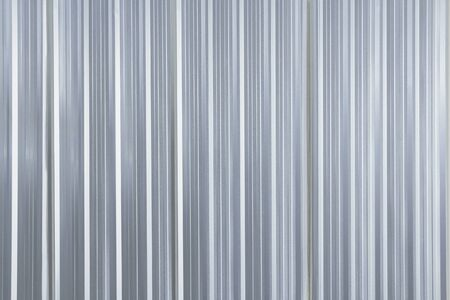 Metal plate sheet fence seamless surface of galvanized steel texture corrugated for wall in a construction site and Industrial building.