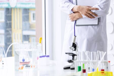 Scientists or researcher medical are education and research in lab with microscope and glassware test tube colorful at the science laboratory.