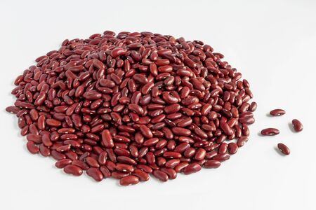 Heap of  red beans pile isolated on white background with copy space for text. Concept food for healthy. Red beans is a leguminous plant native to Asia, widely cultivated for its edible seeds.