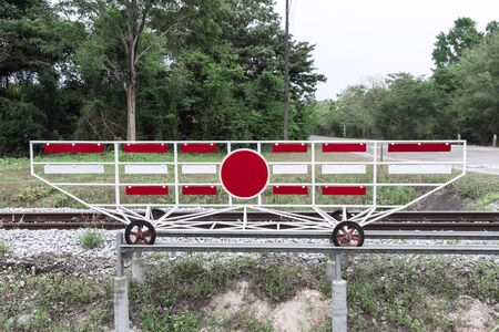 Blank sign train track on railway railroad crosses in line road of countryside for warning danger and safety traffic.