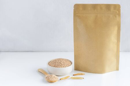 Bamboo worm powder. Bamboo Caterpillar flour for Insects eating as food edible items made of cooked insect meat in bowl and spoon with package bag, it is good source of protein. Entomophagy concept.