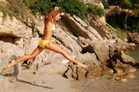 Young woman jumping in the water Stock Photo - 8575058