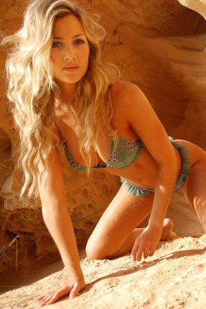 Beautiful young y model posing in lingerie at seaside outdoors photo