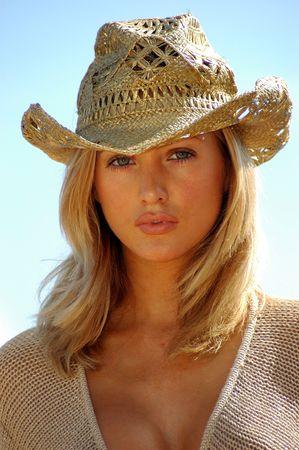 y blondy with gold cowboy hut  photo