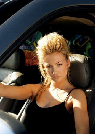 supergirl: Blond punk girl sitting inside a car