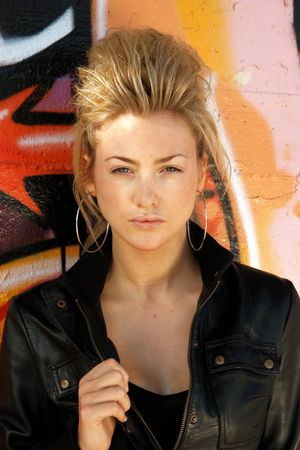 misbehaving: Blond punk girl with a leather jacked