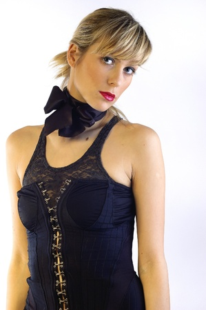 beautiful young blond girl wearing black corset and black bow on a neck photo