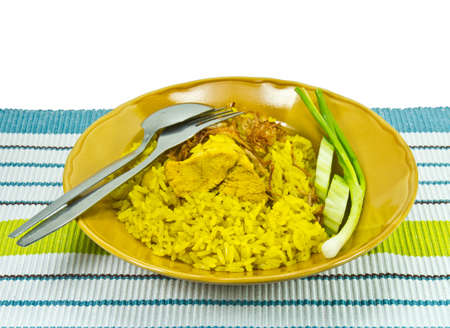 Rice mixed with spices and chicken.