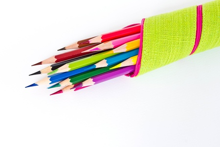 Colored pencil in the bag on a white background