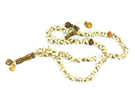 Wooden rosary on a white background  photo