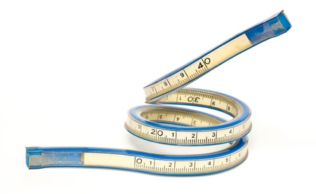 old flexible curve ruler on a white backgroud.