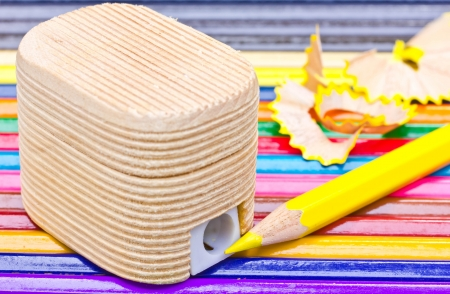 Sharpener made of wood And crayons. photo