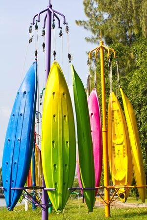 Colorful of Canoe hanging on a pole  photo