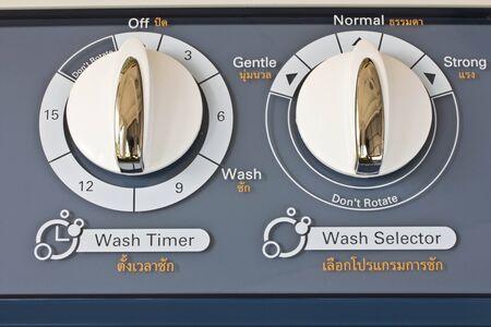 Adjust button on the washing machine.