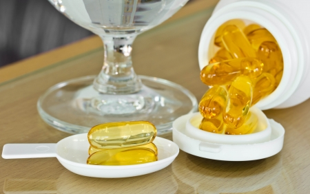 Cod liver oil for health. Stock Photo - 16843844