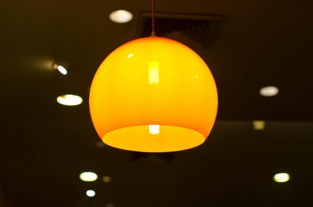 Yellow light hanging on the ceiling. photo