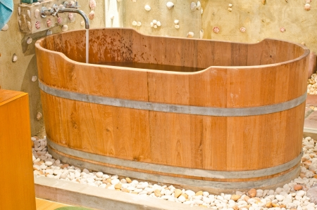 wooden bathtub in barrel shape western style photo