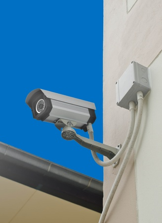 CCTV for security in the city on blue background  photo