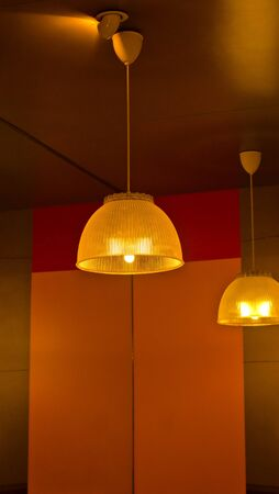 Yellow light hanging on the ceiling  photo