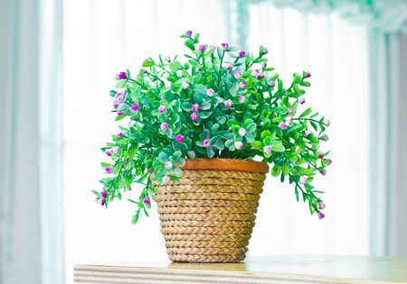 Artificial flowers in pot made from natural materials
