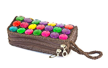 colorful bag made of natural materials on a white  Stock Photo