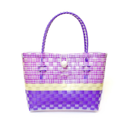 The retro bag made of woven plastic on a white  photo