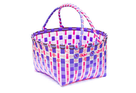 The retro bag made of woven plastic on a white background  photo
