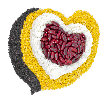 Cereal Grains in to a heart shaped, red beans, green beans, rice, black sesame seeds on white background  photo
