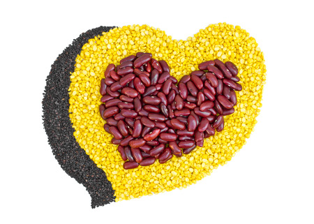 Cereal Grains in to a heart shaped, red beans, green beans, black sesame seeds on white background  photo