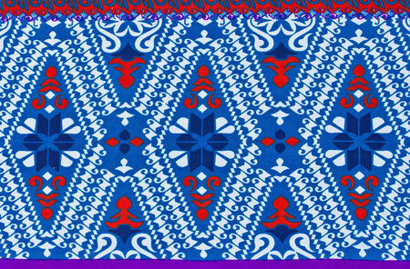 Pattern on the fabric of the sarong background photo