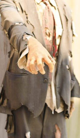 fragmentary: Zombie hand in fragmentary clothes