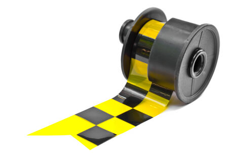 Roll of yellow and black caution tape  on white background