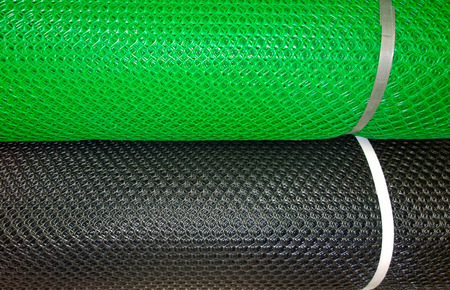 Green and black plastic mesh background